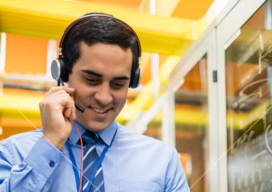 Image of technical support man with headphones